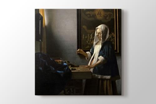 Woman Holding a Balance görseli.